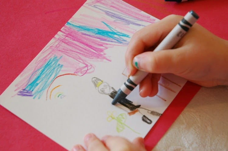 Kids writing letters to troops as an act of kindness