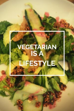 Vegetarian lifestyle text over plate of green salad