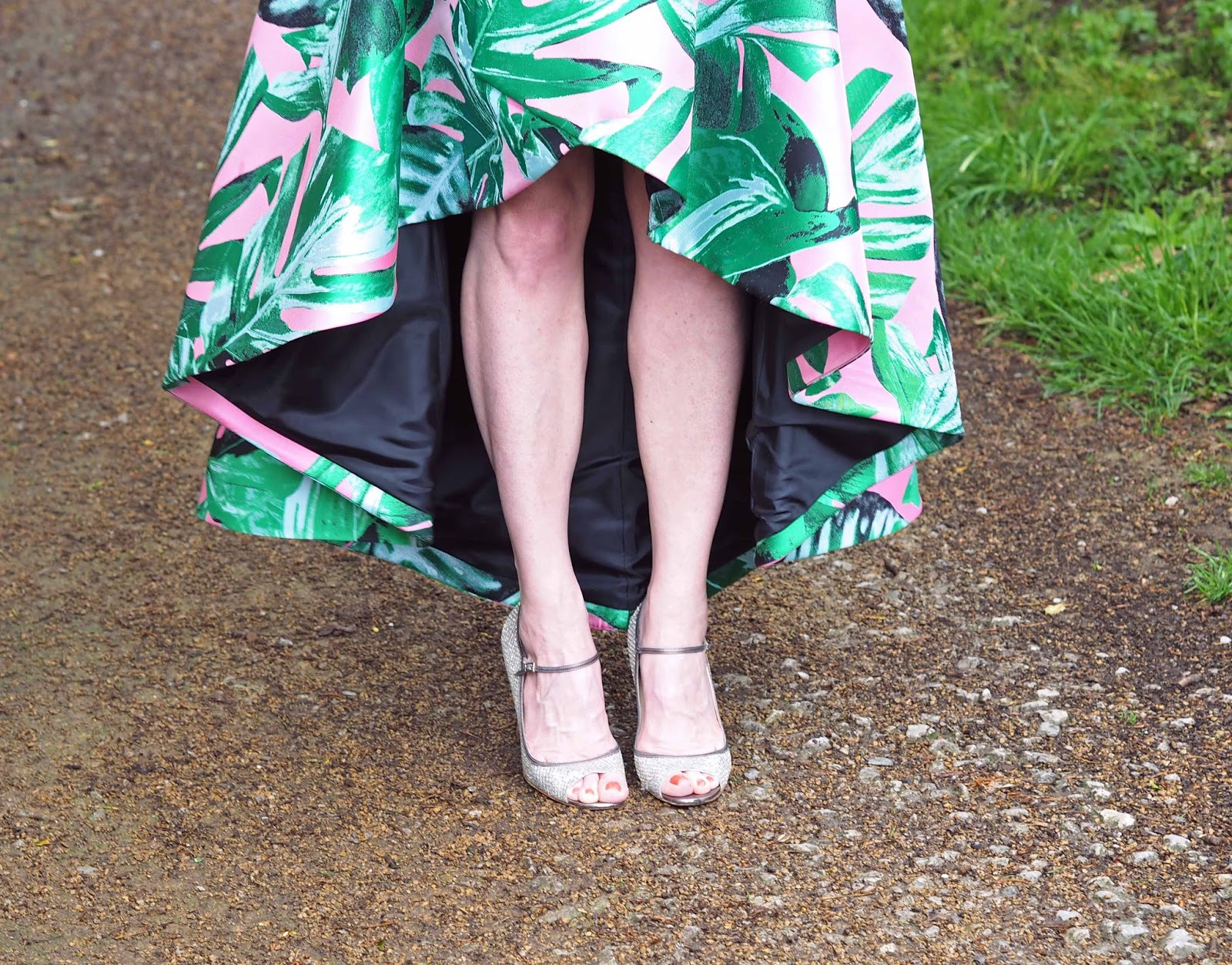 Asymmetric hem statement skirt, pink and black with large leaves, pockets and contrast lining champagne glitter Jimmy Choo sandals, occasionwear,