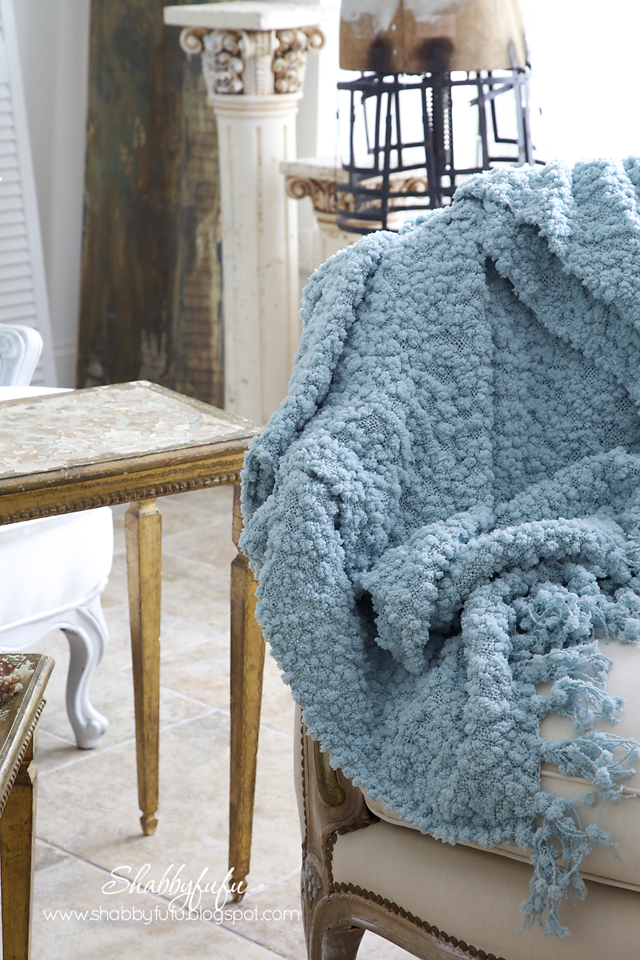 five minute styling tips - textured and soft blue throw blanket over a white upholstered coach