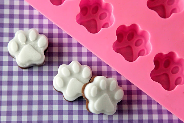 Homemade carob and coconut oil dog treats with paw shaped silicon mold
