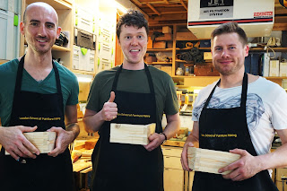 Three men showing off their woodwork joints