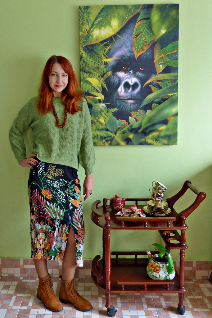 African print skirt, light green woolen sweater, suede boots