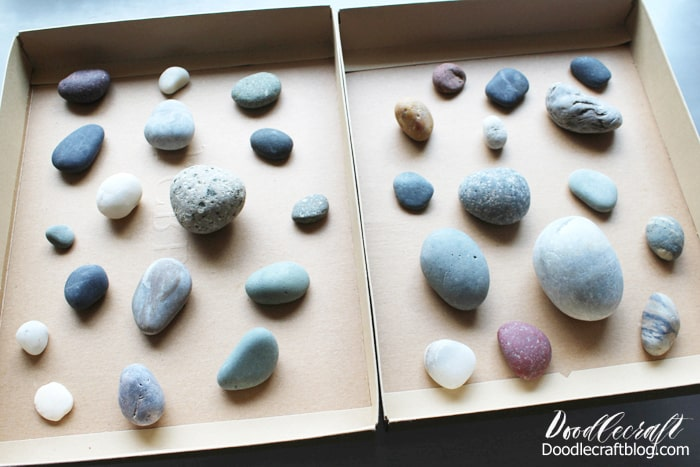Smooth rocks set on cardboard to spray with resin