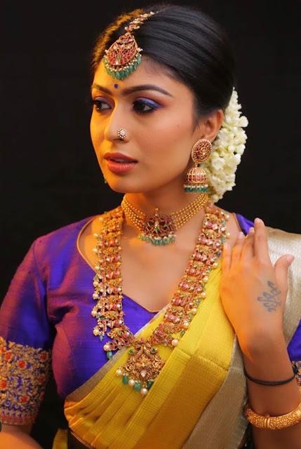 Bride in Jumbo Jhumkas Maang Tikka