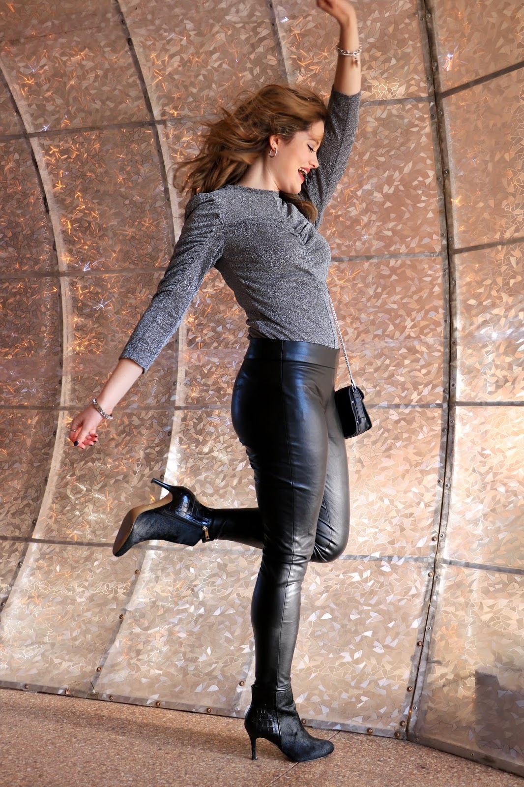 Nyc fashion blogger Kathleen Harper's NYE outfit of a sparkle top and leather leggings.