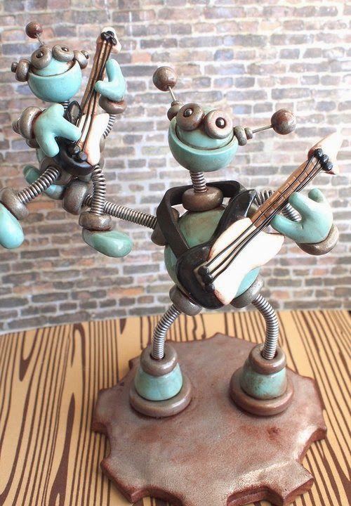 02-Father-Son-Guitar-Playing-HerArtSheLoves-Clay-Robot-World-Sculptures-www-designstack-co