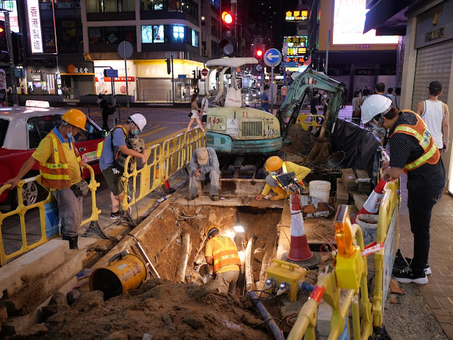 construction crew at an excavation next to Dundas Street in Hong Kong