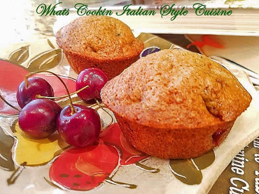 These are muffins baked with fresh cut up sweet bing summer cherries. They are sweet, moist muffins with chopped cherries inside baked on a fruit designed plate
