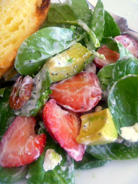 Strawberry Avocado Spinach Salad: Tender spinach forms the base of the salad and is topped with buttery avocado, sweet juicy strawberries, crunchy pecans, and tangy goat cheese, all drizzled with a Poppyseed dressing to top it off. - Slice of Southern