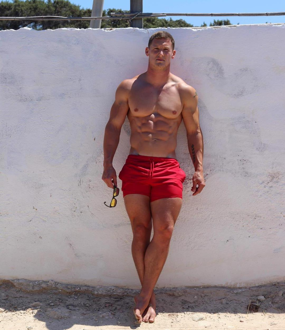 shirtless-beefcake-daddy-sunny-body-red-shorts-huge-pecs-muscle-dilf-abs