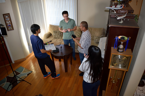 Director Richard Par discusses a flashback scene for THE BROKEN TABLE with Nicholas Mariano ('Adam'), while production assistant Louis Huynh and Majdolene Abualfaraj ('Jennifer') look on...on October 26, 2019.
