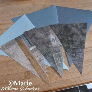 3 plain gray triangle flag sections with 3 scrapbook paper pieces