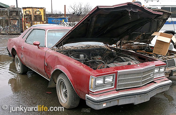 Complete, red 1977 Buick Regal sold to scrap dealer in Birmingham, Alabama.