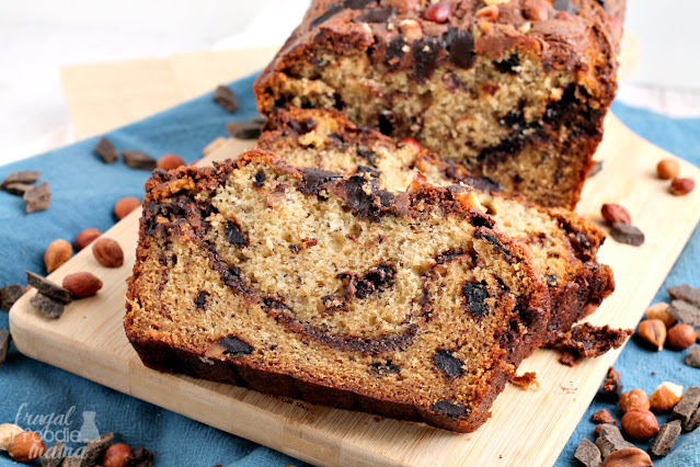 This homemade Chocolate Hazelnut Banana Bread is chock full of toasted hazelnuts and dark chocolate chunks. But the best part of this banana bread just might be the swirl of chocolate hazelnut spread baked right into each slice.