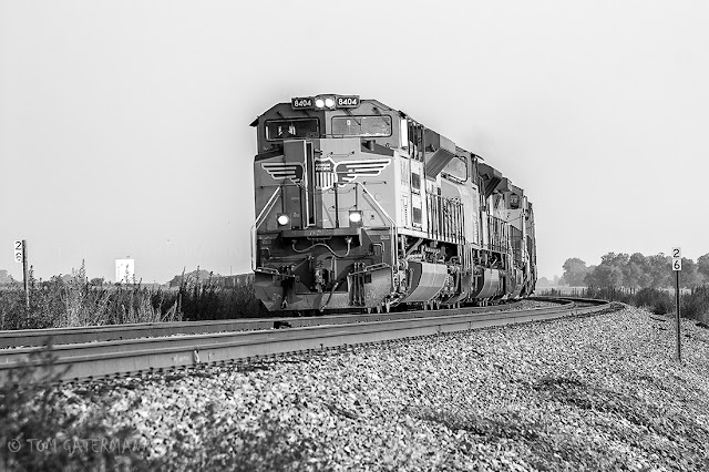 UP 8404 leads a grain train on the Chester Subdivision at Chalfin Bridge, IL.