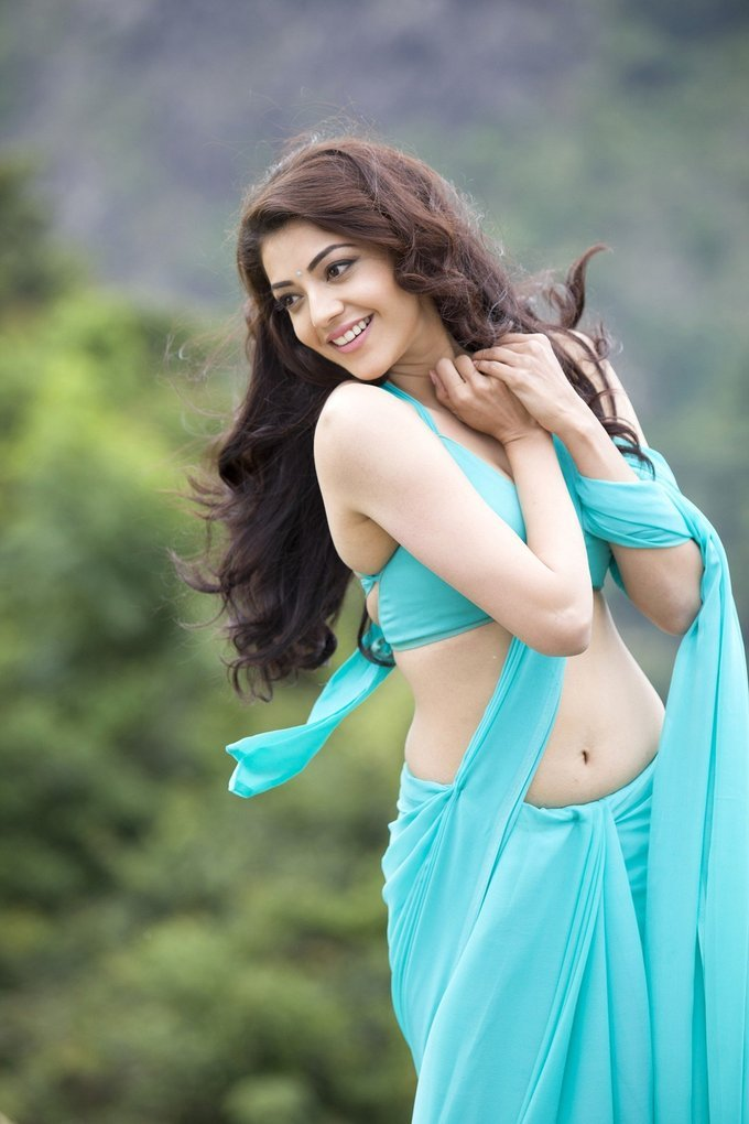 Kajal Aggarwal Hot Navel Hip Gallery In Transparent Blue Saree