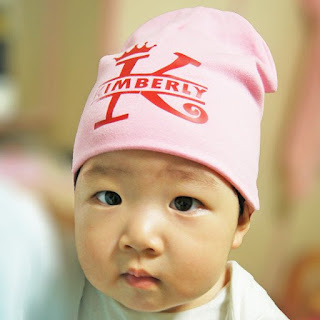 Pink Baby Beanies on child