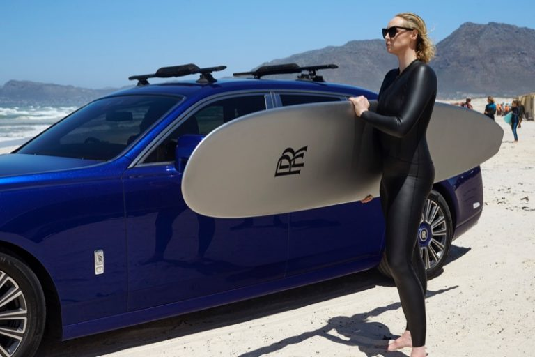 Gwendoline Christie poses with a surfboard on set of Rolls-Royce Phantom film