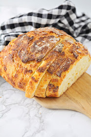 This no-knead cheddar artisan bread is perfect for beginners, and tastes amazing! It has a chewy crust, a tender middle, and a fantastic cheddar flavor!