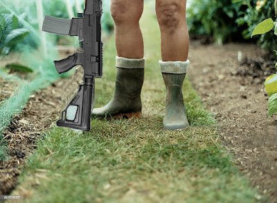 Naked soldier in wellington boots