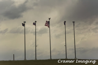 Cramer Imaging's photograph of the Grand Teton Council 2016 Jamboral flags against the sky, on a hill, in Firth, Idaho