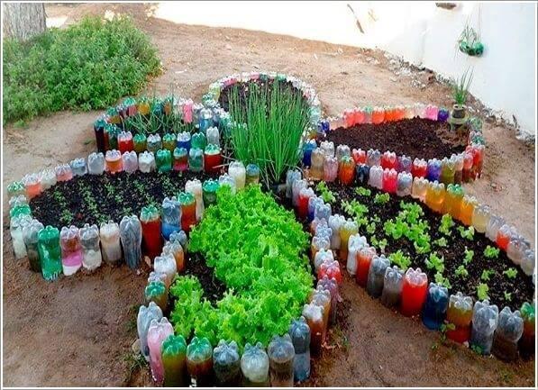 Botellas de pl stico recicladas para jardines y huertas for Antorchas para jardin caseras
