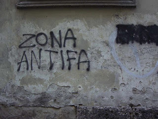 "Wall with spray-painted graffiti: ""Zona Antifa"""