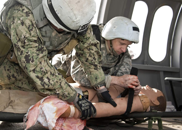 Two students train to help the wounded on a simulated aircraft