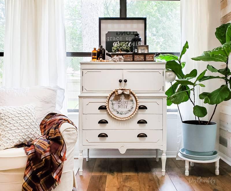 white cottage dresser and amber glass bottles