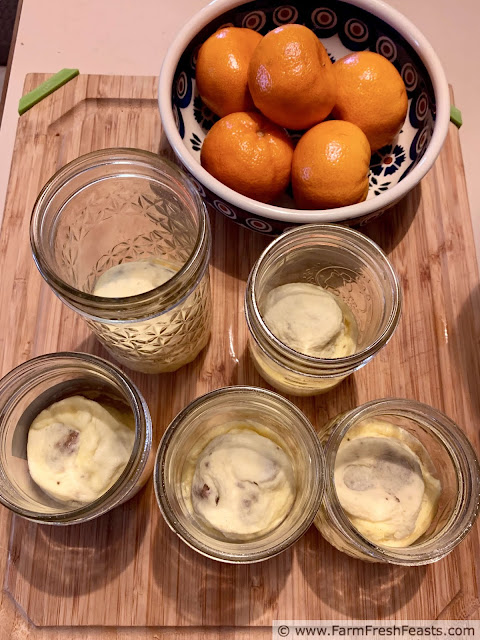 photo of sous vide sausage egg bites made in half pint canning jars, along with a dish of clementines