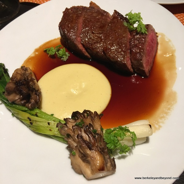 roasted New York steak with sweet corn mousse, mitake mushrooms, truffle jus, and charred scallions at Campton Place Restaurant in San Francisco, California