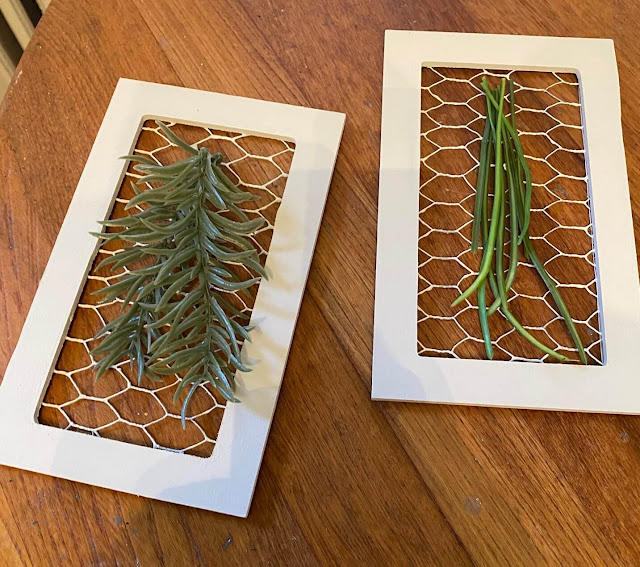 Photo of framed chicken wire with faux herb sprigs