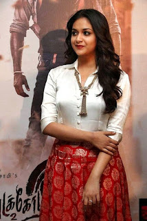 Keerthy Suresh in White Dress with Cute Smile at Pandem Kodi 2 Promotions 1