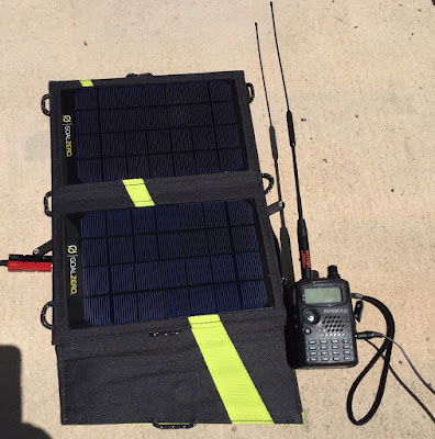 The Nomad 7 solar panel in full sun charging a TH-F6A.