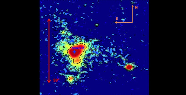 MAMMOTH-1 is an extended blob of gas in the intergalactic medium called an enormous Lyman-alpha nebula (ELAN). The color map and contours denote the surface brightness of the nebula, and the red arrows show its estimated spatial extent. (Image credit: Figure 2 of Cai et al., Astrophysical Journal)