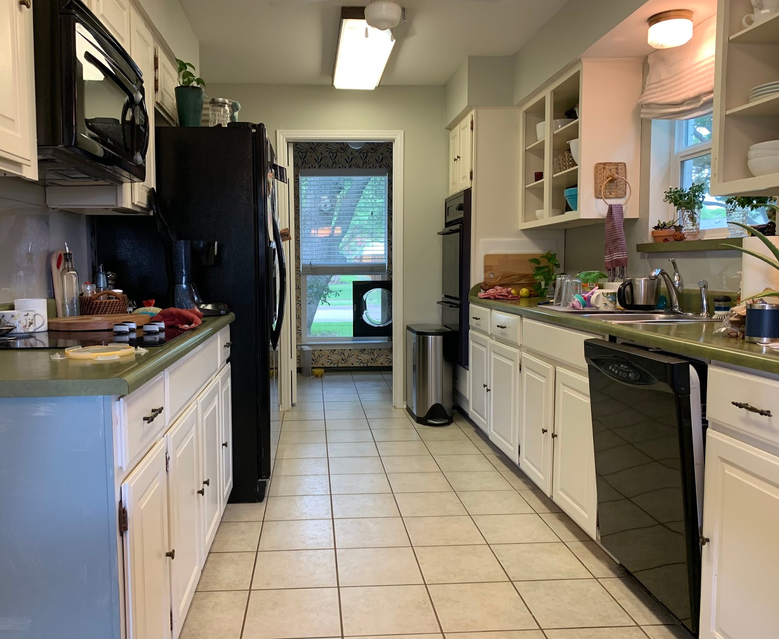 one room challange before: green countertops, paint over wallpaper, galley kitchen