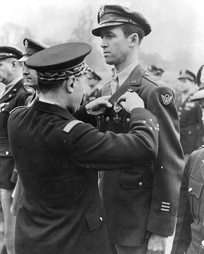 Photo of actor Jimmy Stewart in uniform receiving Croix de Guerre with Palm