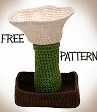 http://www.ravelry.com/patterns/library/lily-mushroom-trinket-holder