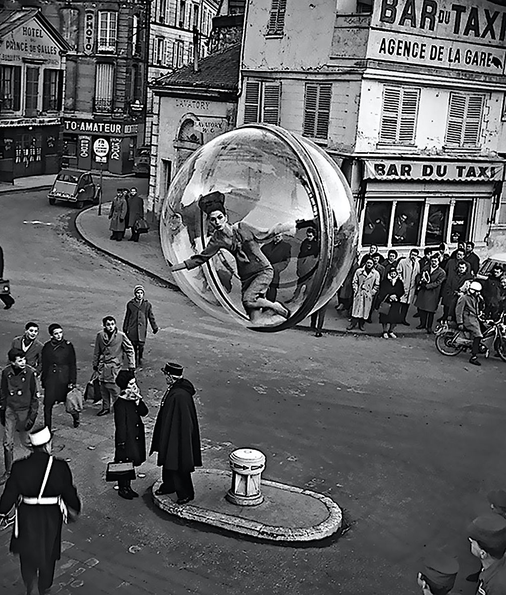 a 1963 Melvin Sokolosky fashion photo of a woman in a floating sphere