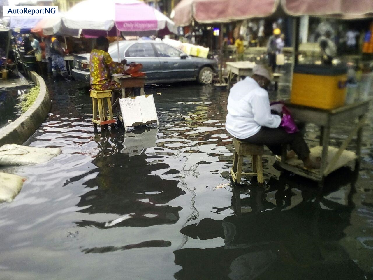 Flooded Jankara Market In Lagos Where Traders, Residents Wear Rain Boots To Work 4