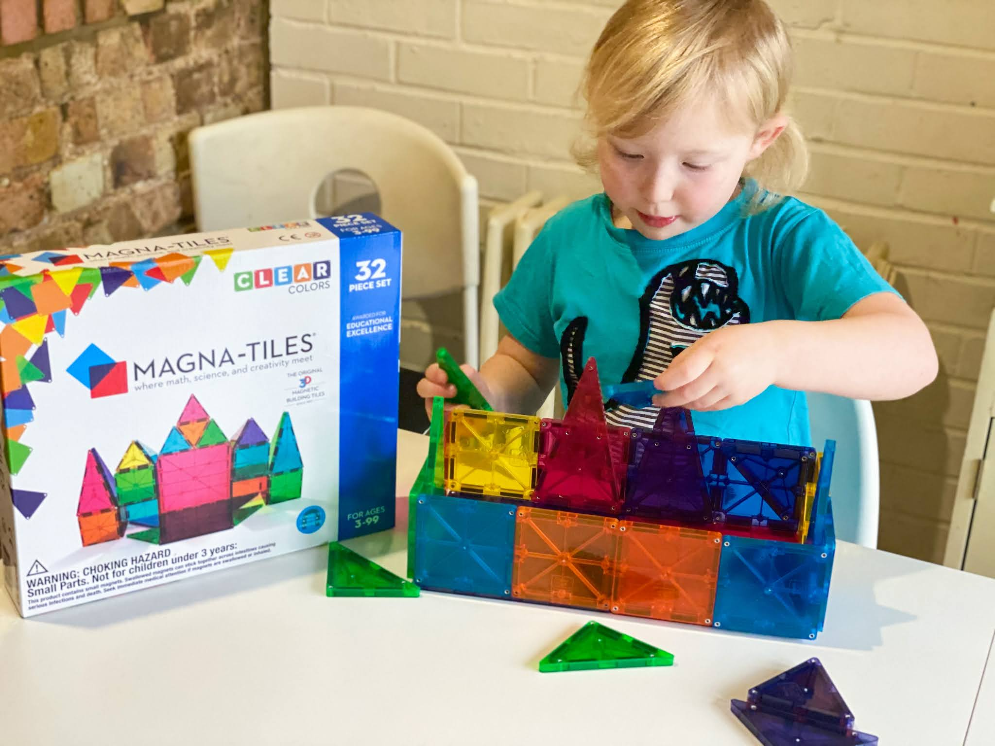 Magna-tiles Clear Tiles 32 piece set being played with by a 5 year old