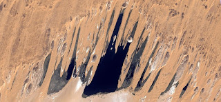 The mouth of terror,abstract landscapes of deserts  ,Abstract Naturalism,abstract photography deserts of Africa from the air,abstract surrealism,mirage in desert,fantasy forms of stone in the desert