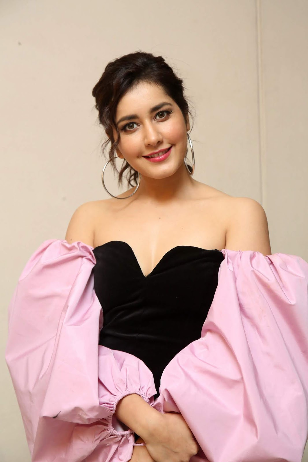 Raashi Khanna in a beautiful Sleeveless Black Deep neck Gown