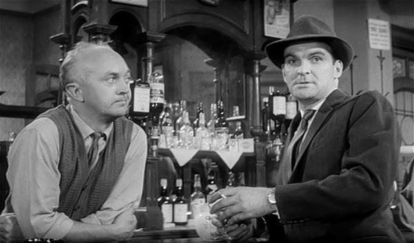 George A. Cooper and Stanley Baker at the bar in a pub