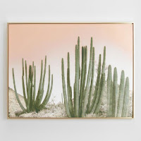 cactus wall art in a gold frame
