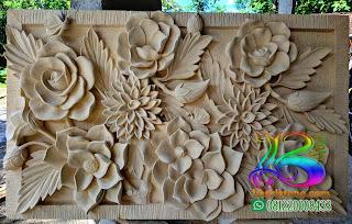Batu ukir atau relief untuk hiasan dinding rumah