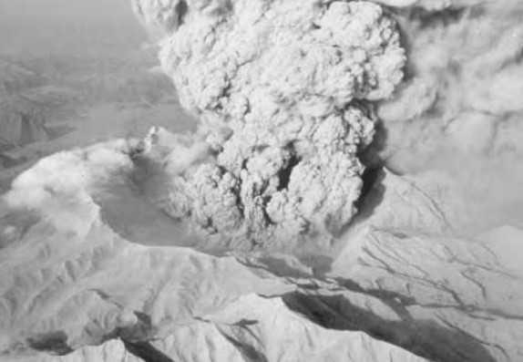 Aerial view of the north side of Pinatubo crater with a small explosion in progress on June 22, 1991. (1)