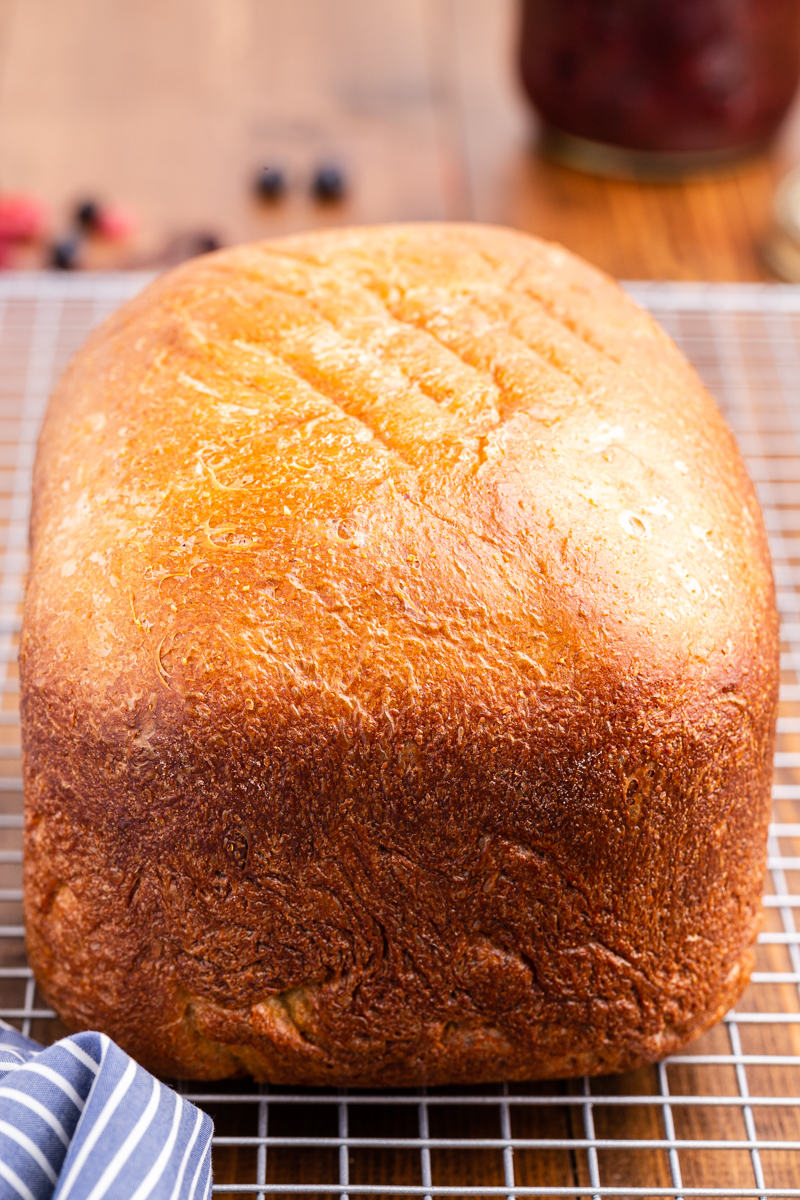 Closeup photo of a loaf of keto bread cooling on a cutting board.