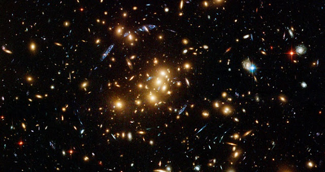 Galaxy clusters like this one can contain hundreds or thousands of galaxies. Credit: NASA, ESA, M.J. Jee and H. Ford (Johns Hopkins University)